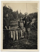 view Frank DuMond and guides holding fish digital asset number 1
