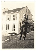 view Frank DuMond standing by old farm house digital asset number 1