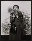 view Claire Falkenstein with one of her sculptures digital asset number 1