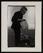 view Photograph of Andy Warhol emptying a vacuum cleaner at the <em>Art in Process V</em> exhibition digital asset number 1