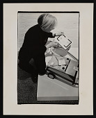 view Photograph of Andy Warhol examining vacuum cleaner at <em>Art in Process V</em> exhibition digital asset number 1