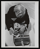 view Photograph of Andy Warhol writing a note on vacuum cleaner at <em>Art in Process V</em> exhibition digital asset number 1