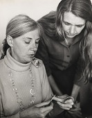 view Arline M. Fisch teaching a student to crochet wire digital asset: page 1
