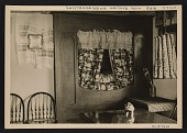 view The wall bed, decorated with Russian embroidery, in Leon Gaspard's gallery in Taos. digital asset number 1