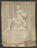 view Photograph of Karl Bitter standing by his sculpture of Alexander Hamilton digital asset: front