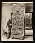 view Chaim Gross posing with one panel of his sculpture <em>Six days of creation</em> digital asset number 1