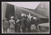 view Officers standing by an army plane loaded with the Ghent Altarpiece digital asset number 1