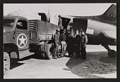 view Soldiers standing by a truck and plane at Munich airport digital asset number 1
