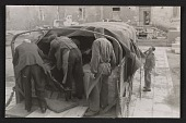 view Men loading a truck with a shipment of art at Munich Central Collecting Point digital asset number 1
