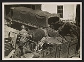 view George Stout and two unidentified men loading a truck at Altaussee, Austria digital asset number 1
