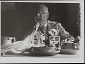 view Photograph of William Mills Ivins, Jr. seated at a table digital asset number 1