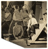 view Rockwell Kent seated near a mural digital asset number 1
