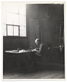 view Rockwell Kent working at a desk digital asset number 1