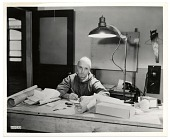 view Rockwell Kent working at his desk digital asset number 1