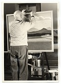 view Rockwell Kent with a landscape painting digital asset number 1
