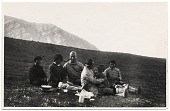 view Rockwell Kent sitting on a hillside with a group of natives in Greenland digital asset number 1