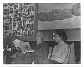 view Rockwell and Sally Kent looking through one of his books digital asset number 1