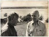 view Rockwell Kent and an unidentified man talking during a visit to the USSR digital asset number 1