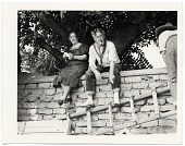 view John and Dolly Sloan seated on a wall at their Santa Fe ranch digital asset number 1