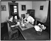 view Dolly and John Sloan seated at the table in their Santa Fe home digital asset number 1