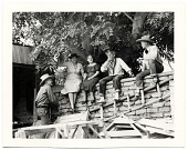 view Dolly and John Sloan and friends sitting on a wall at the Sloan's Santa Fe Ranch digital asset number 1
