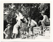 view John and Dolly Sloan and friends sitting on a wall at Sloan's Santa Fe Ranch digital asset number 1