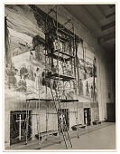 view Leon Kroll painting a mural in the Worcester Memorial Auditorium digital asset number 1