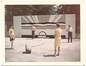 view Four people outside with Roy Lichtenstein's billboard <em>Super sunset</em> digital asset number 1