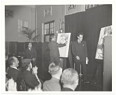 view Abril Lamarque watching two caricaturists on stage (large format) digital asset number 1