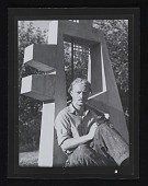 view Charles Biederman with cat in front of s<em>Outdoor Sculpture</em> digital asset number 1
