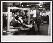 view Men working on Alexander Liberman's <em>Torque</em> sculpture digital asset number 1