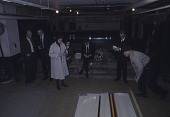 view Clement Greenberg, Michael Fried, Marcella Brenner and others grouped around an unrolled Morris Louis canvas at Santini Bros. warehouse digital asset number 1