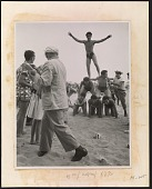 view Reginald Marsh sketching men building a human pyramid on the beach digital asset number 1