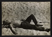 view A man sleeping on the beach at Coney Island digital asset number 1