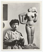 view Unidentified female sculptor with her work digital asset number 1