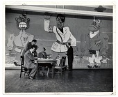 view Art Students League faculty seated around a table in front of a mural digital asset number 1