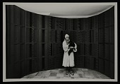 view Louise Nevelson with cat in front of wall sculpture digital asset number 1