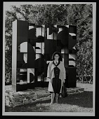 view Louise Nevelson standing in front of her artwork at Pocantico Hills digital asset number 1