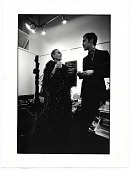 view Louise Nevelson talking with an unidentified man at an exhibition opening digital asset number 1