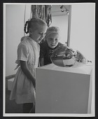 view Two girls inspecting an item in the <em>Objects: U.S.A.</em> exhibit digital asset number 1