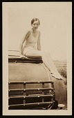 view Elizabeth Orr sitting on a car digital asset number 1
