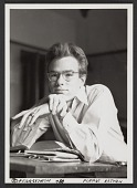 view Andy Warhol seated at a desk digital asset number 1
