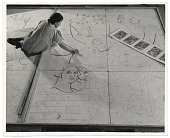 view Photograph of woman working on a floor mosaic digital asset number 1