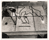 view Photograph of man working on a floor mural digital asset number 1