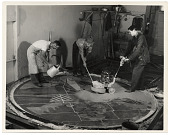 view Photograph of men working on a floor mural digital asset number 1