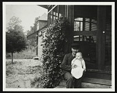 view John Frederick Peto on the porch of his home in Island Heights, New Jersey, holding his daughter Helen digital asset number 1
