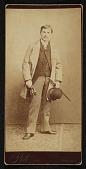view John Frederick Peto standing, holding a bowler hat digital asset number 1