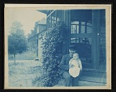 view John Frederick Peto on the porch of his home in Island Heights holding his daughter Helen digital asset number 1