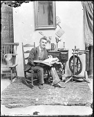 view John F. Peto in a rocking chair, holding an open book digital asset number 1