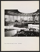 view Interior view of the United States Pavilion at the Brussels World's Fair, with fashion show in progress digital asset number 1